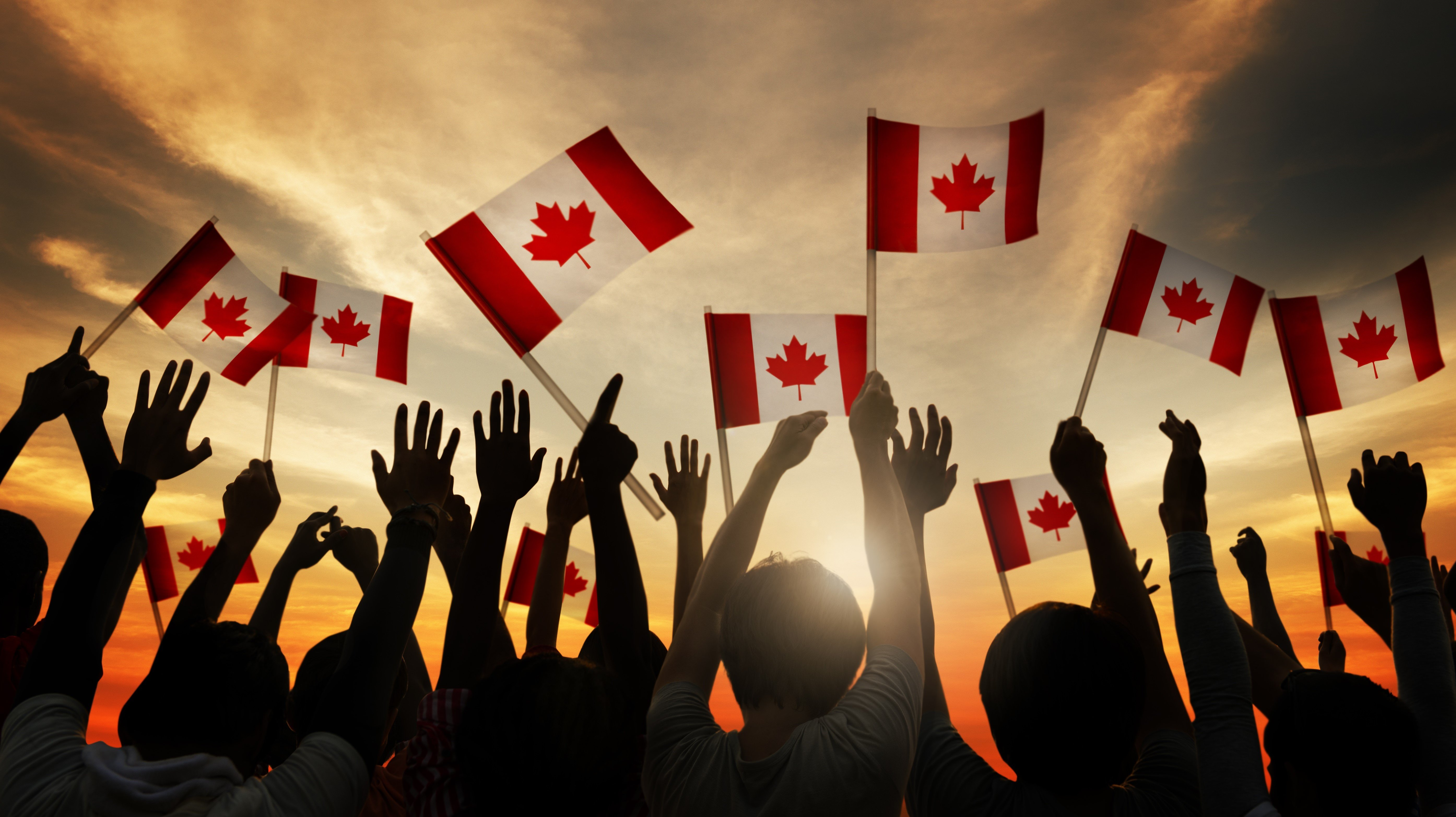 shutterstock_230264902 waiving canada flags - Copy